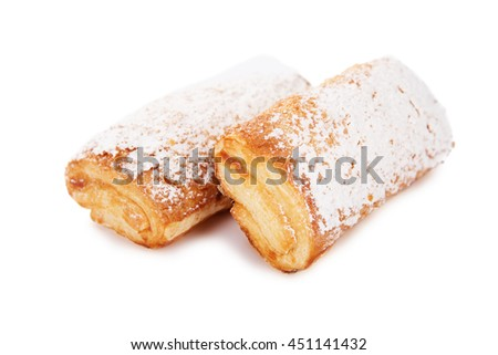 Cookies of puff pastry topped with powdered sugar isolated on white background - stock photo