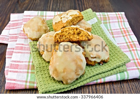 Cookies pumpkin whole on a green and plaid towels and wooden boards background