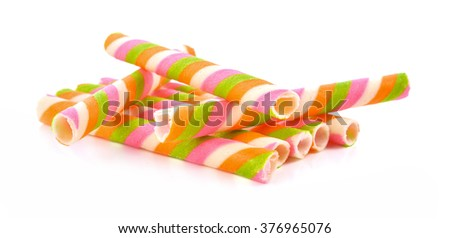 Cookies roll rods colorful isolated on white background . - stock photo