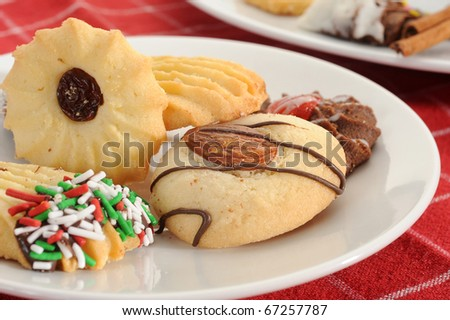 Cookies served on a plate on red background