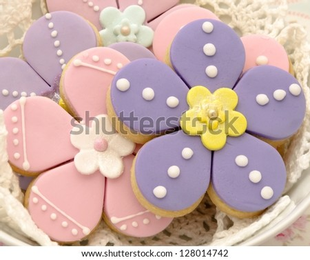 Cookies shaped flowers decorated - stock photo