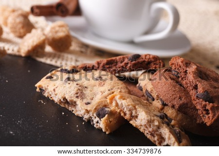 Cookies with chocolate chips and a cup of coffee close-up on the table. horizontal