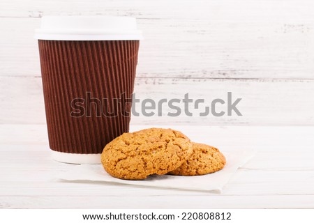 Cookies with coffee on table - stock photo