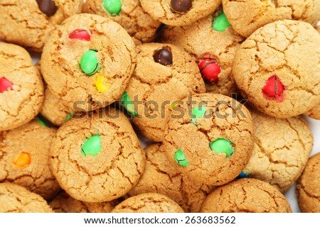 Cookies with colorful candy background - stock photo