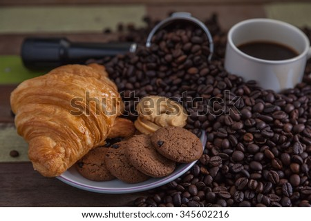 Cookies with cup of coffee with beans - stock photo
