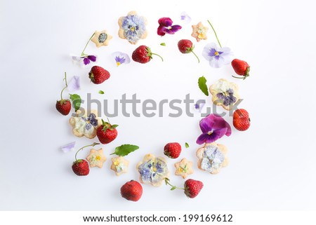 cookies with flowers and fresh berries - stock photo
