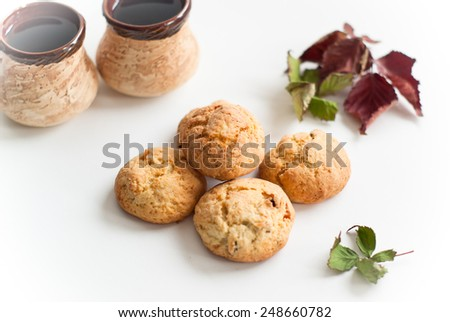 cookies with raisins and nuts and some autumn leaves - stock photo