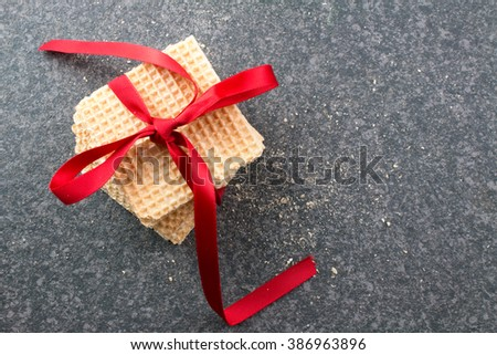 Cookies with Red Ribbon on Rustic Table.