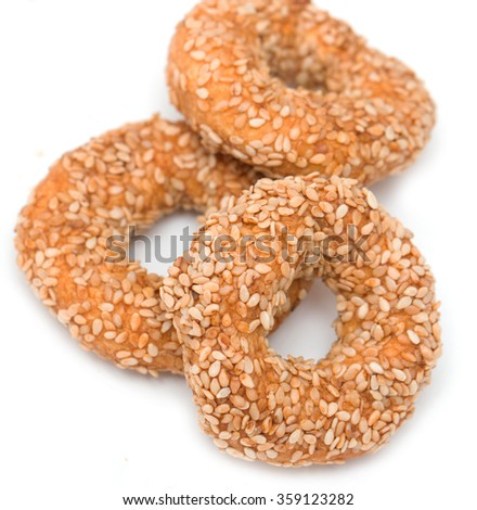 cookies with sesame seeds on a white background