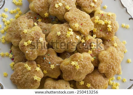 Cookies with sprinkles on a plate - stock photo