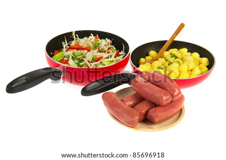 cooking a fresh dairy meal with potatoes vegetables and meat