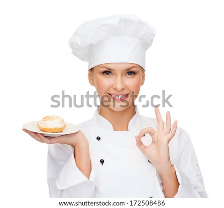 cooking and food concept - smiling female chef, cook or baker with pie on plate and ok sign - stock photo