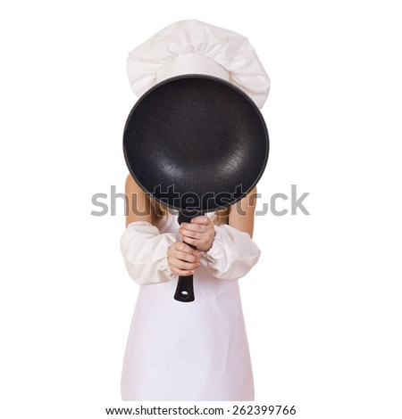 Cooking and people concept -  little girl in cook hat with frying pan - stock photo