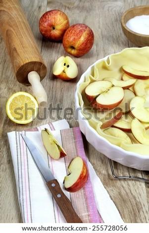 Cooking apple pie, kitchen utensils and ingredients - stock photo