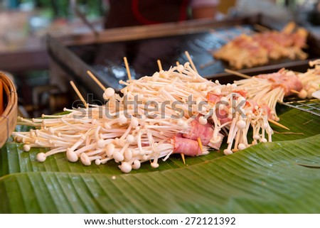 cooking, asian kitchen, sale and food concept - mushrooms at street market - stock photo