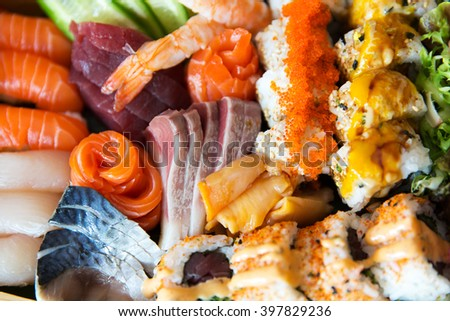 cooking, asian kitchen, seafood, eating and food concept - sushi set at restaurant