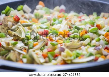 Cooking boiling Mediterranean veggies on a pan - stock photo