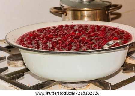 cooking cherry jam - stock photo