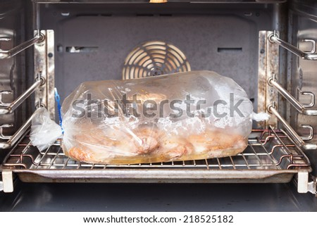 cooking chicken in the oven on the oven bag - stock photo