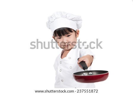 Cooking Concept :cute happy little baby cooking something - stock photo