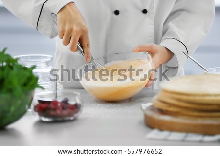 Cooking concept. Professional confectioner making delicious cream, closeup