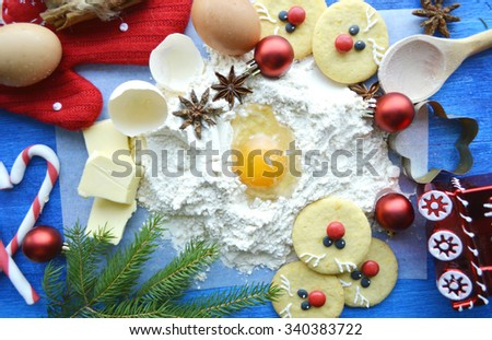 cooking, cooking Christmas ginger cookies, cupcakes. cookie cutters, deer, teapots .book recipes. the magic of Christmas kitchen.Christmas gingerbreads  - stock photo