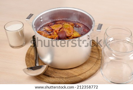 Cooking delicious drain jam in kitchen - stock photo