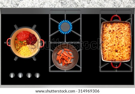 Cooking Food on a Gas Stove top panoramic view - stock photo