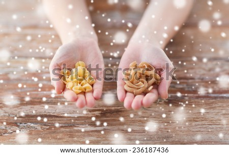 cooking, food, people and home concept - close up of male or female cupped hands with different pasta variations - stock photo