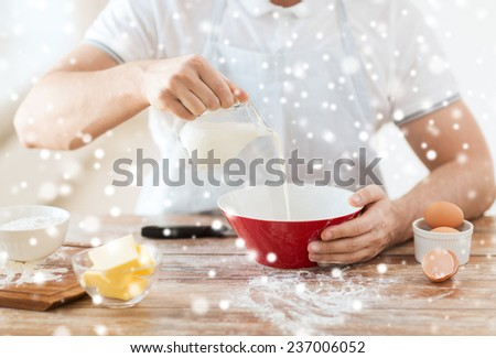 cooking, food, people and home concept - close up of man pouring milk into bowl and other ingredients - stock photo