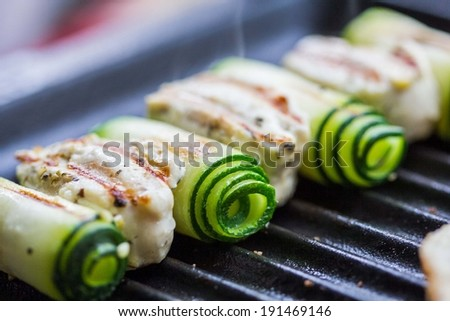 Cooking grilled chicken kebab, shashlik on skewers with rolled zucchini, toast, tasty dish - stock photo