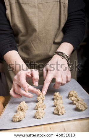 Cooking homemade cookies in Christmas even - stock photo