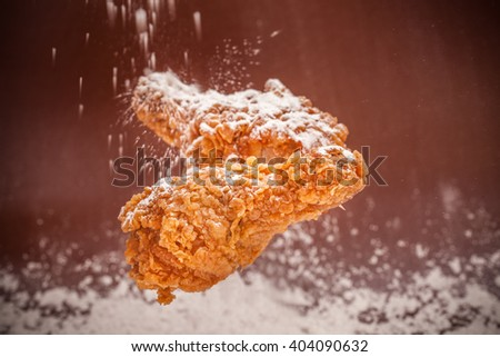 Cooking in kitchen flour and fried chicken - stock photo