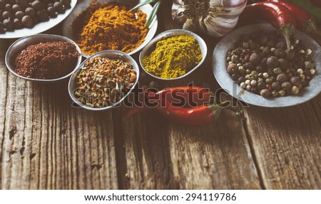 Cooking ingredients, spice on old wooden background. Toned image - stock photo