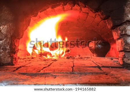 Cooking meal in the traditional hearth furnace