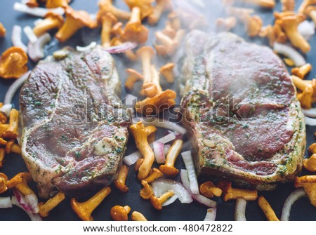 Cooking meat with mushrooms and onion
