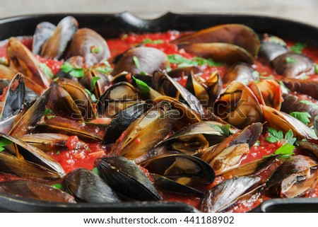 cooking mussel opens in tomato sauce
