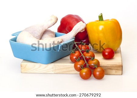 Cooking of a chicken with vegetables