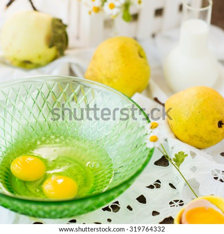 cooking of a homemade yellow pear pie on vintage background - stock photo