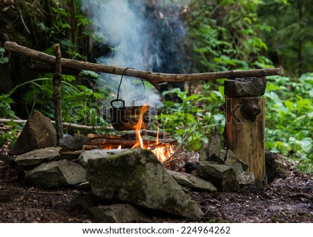 Cooking on campfire - stock photo