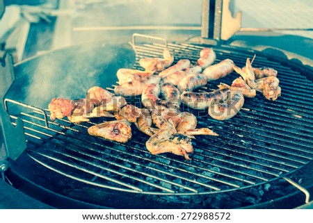 Cooking on the barbecue grill/retro filter - stock photo