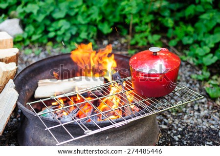 Cooking over a open fire pit - stock photo