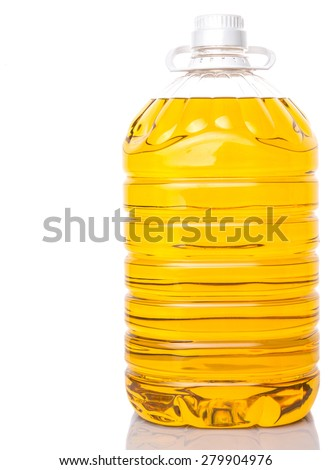 Cooking palm oil in large plastic container over white background - stock photo