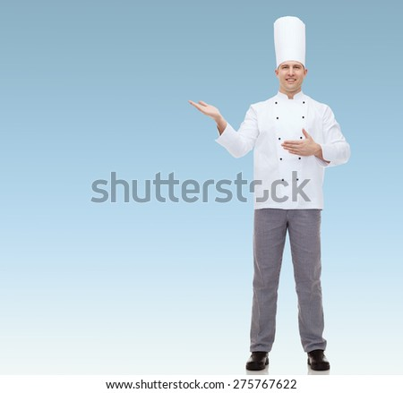 cooking, profession and people concept - happy male chef cook inviting  over blue background - stock photo