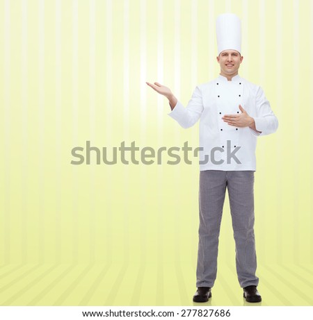cooking, profession and people concept - happy male chef cook inviting over yellow background - stock photo