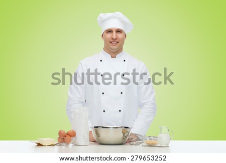 cooking, profession, haute cuisine, food and people concept - happy male chef cook baking over green background - stock photo