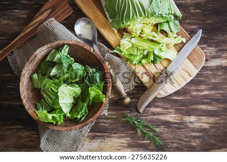 cooking salad chinese cabbage on the old wooden background. vegetables from the garden. top view. health and diet food - stock photo