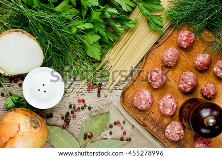 Cooking soup with meatballs or spaghetti with meatballs ingredients top view - stock photo