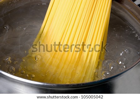 cooking spaghetti in hot water - stock photo