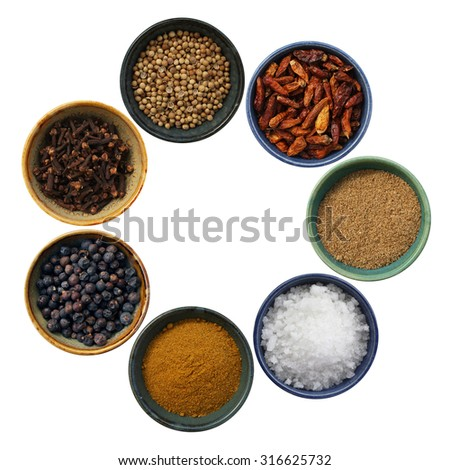 Cooking spices in a circle on white background - stock photo